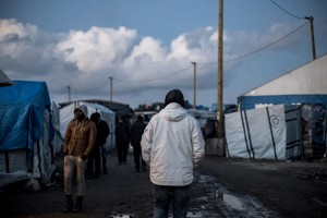 A man walks alone in the main street of the Jungle. In Calais, northern France, February 23, 2016